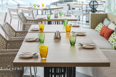 Tables set for meal in restaurant interior photo