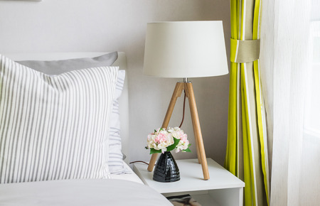 modern bedroom with wood lamp at home photo
