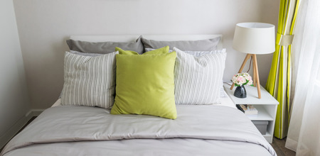 modern bedroom with green pillow on bed