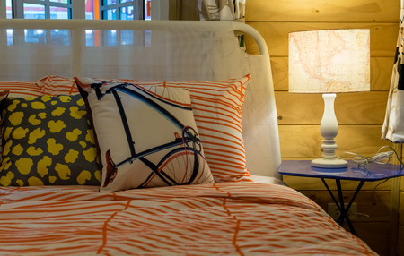 signle: colorful pillows on bed with white lamp