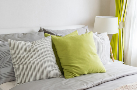 bed linen: modern bedroom with green pillow on bed