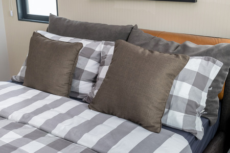 bedspread: bed and brown pillows in modern bedroom