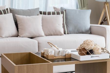decorative tea set in living room interior Foto de archivo