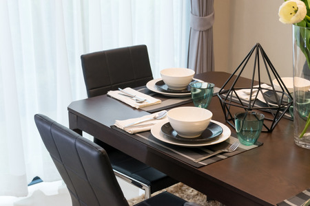 table set on wooden table at home photo
