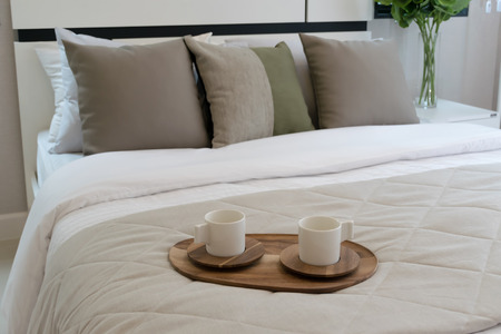wooden bed: Decorative wooden tray with tea set on bed