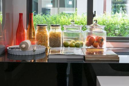 pantry: modern black pantry with utensil in kitchen