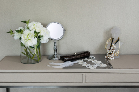 dressing up: Beauty and make-up concept: mirror,jewelry and makeup set on a table