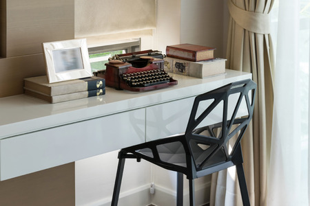 typewriter: decorative working table with typewriter and books