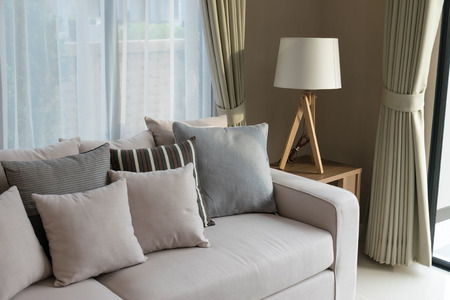 modern living room design with sofa and wooden lamp Foto de archivo