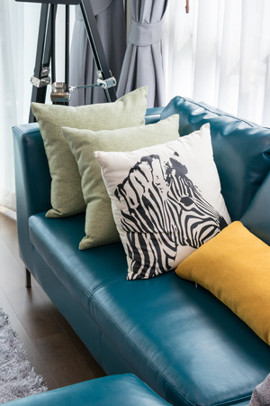 green sofa: modern living room with green sofa and pillows at home Stock Photo