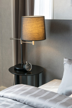 modern bedroom with pillows and lamp Standard-Bild