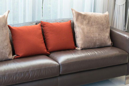 red pillows: modern living room design with sofa and red pillows Stock Photo