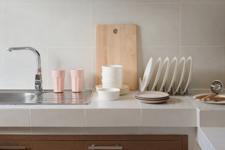 bowl sink: white clean counter in kitchen with utensil at home Stock Photo