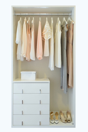 closet: vintage and stylish interior of wooden wardrobe Stock Photo