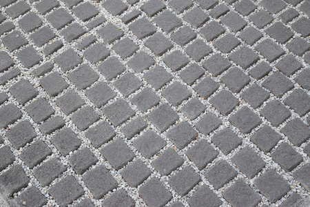 stoned: pattern of granite cobble stoned pavement background Stock Photo