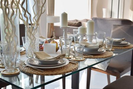 elegant table set in modern style dining room interior Standard-Bild