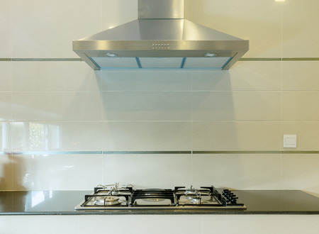 stove: cooking gas stove with hood in modern kitchen