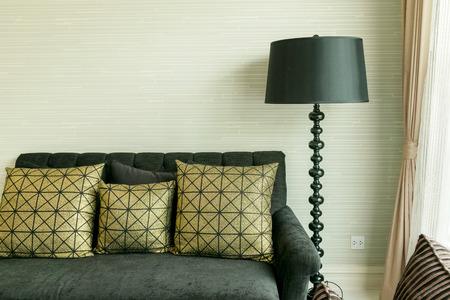 black velvet: elegant living room interior with golden pattern pillows on black velvet sofa