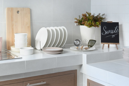 clean home: white clean counter in kitchen with utensil at home Stock Photo