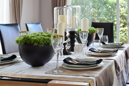 modern dining room: elegant table set in modern style dining room interior Stock Photo