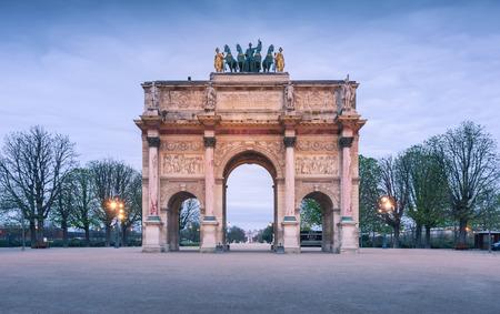 carrousel: Paris, France - April 14, 2013: The Arc de Triomphe du Carrousel as the main entrance to the Louvre Museum.
