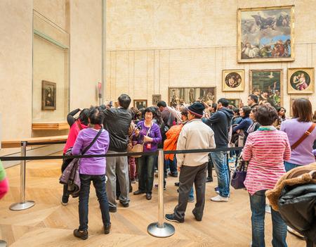leonardo davinci: Paris, France - April 14, 2013: Visitors take photo around The Leonardo DaVincis Mona Lisa in the Louvre Museum. Editorial