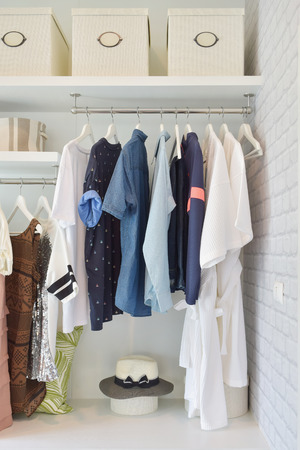 clothing shop: Casual cloths hanging in open wardrobe at modern home