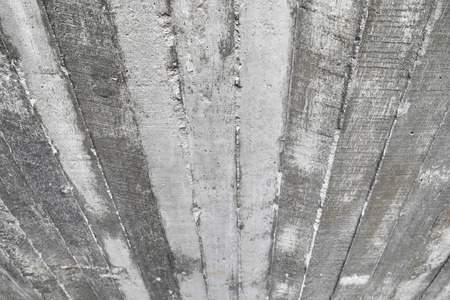wood wall texture: texture of wooden formwork stamped on a raw concrete wall as background Stock Photo