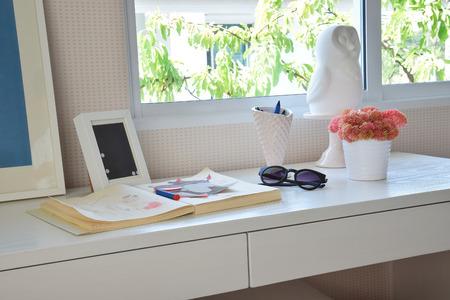 sketchbook: color pencils and sketchbook on wooden table in kids room