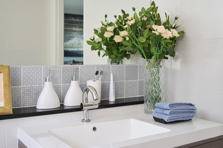bathroom equipment: washbasin with faucet and liquid soap bottle at home