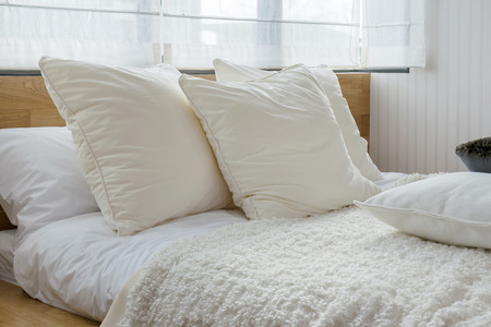 bed sheets: stylish bedroom interior design with black and white pillows on bed. Stock Photo