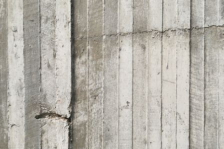 formwork: texture of wooden formwork stamped on a raw concrete wall as background Stock Photo