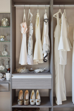 clothing shop: row of white dress with shoes in wardrobe at home