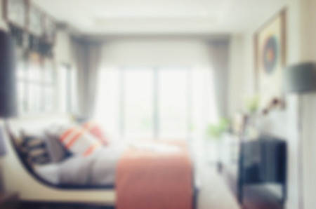 luxury bedroom: defocus blur abstract background of modern bedroom interior
