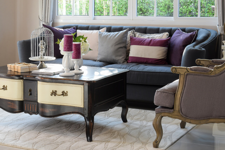 sofa: luxury living room design with classic sofa, armchair and decorative set on wooden table Stock Photo