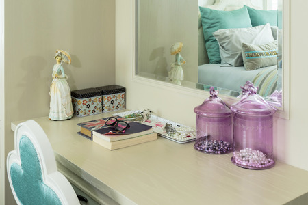 dressing up: Beauty and make-up concept: mirror,jewelry and makeup set on a dressing table