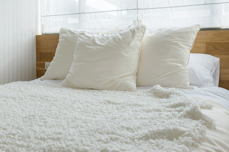 stylish bedroom interior design with black and white pillows on bed. 写真素材
