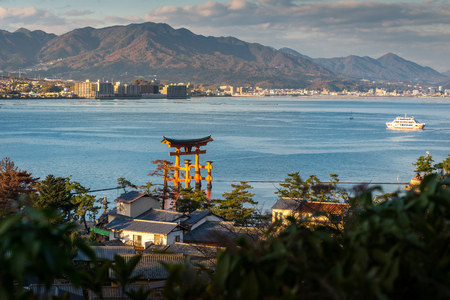 temple tower: High Angle View of Great floating gate O-Torii and Hiroshima city view from Miyajima Island, Japan