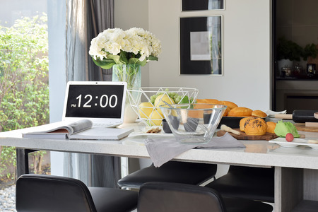 bakeware: Pastry on the white artificial stone top dining table in the modern dining room