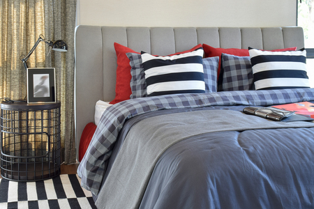 pillow: modern bedroom interior with striped pillow on bed and bedside table lamp at home