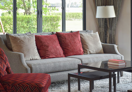 red pillows: modern living room design with red pillows on sofa and decorative table lamp