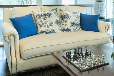 chorme: luxury living room with blue pattern pillows on sofa and decorative chess board