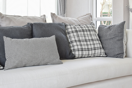 sofa: modern living room interior with black and white checked pattern pillows on sofa Stock Photo