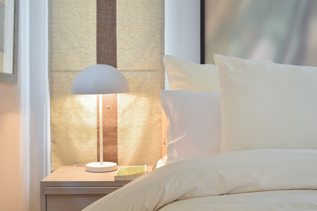 bedside lamp: Reading lamp on bedside table Stock Photo