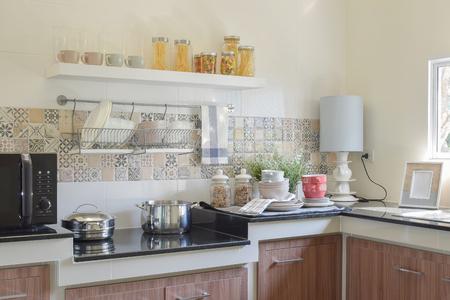 granite countertop: modern ceramic kitchenware and utensils on the black granite countertop Stock Photo