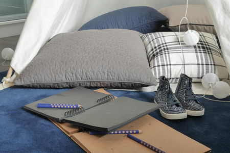 comfy: Notebooks and pillow with comfy space for creative people Stock Photo