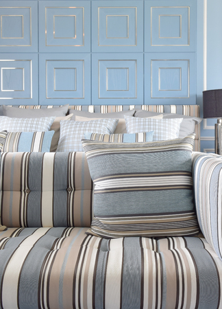 sofa set: Light blue and light brown striped sofa set with classic blue wall