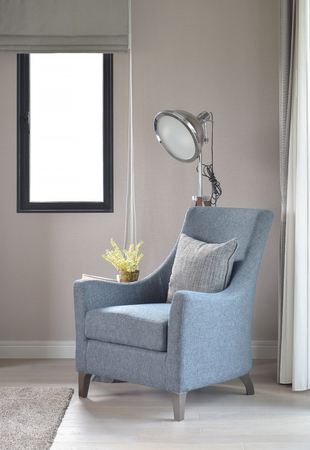Light Blue Armchair With Gray Pillow And Retro Lamp In The Living Room  Stock Photo