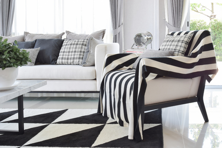 carpet: modern living room interior with black and white checked pattern pillows and carpet Stock Photo