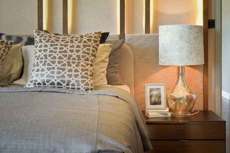 bedside lamp: luxury bedroom with white lamp with picture frame on wooden table Stock Photo